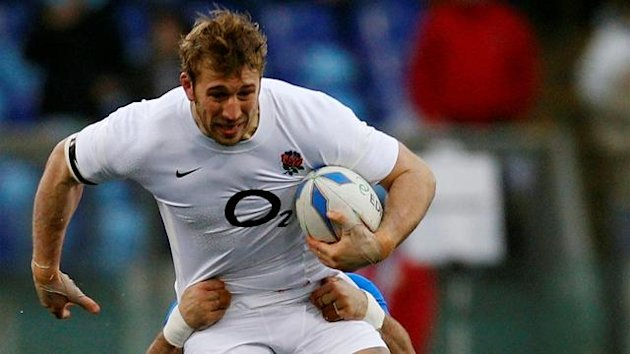England's Chris Robshaw holds off a challenge during their Six Nations rugby union match against Italy at the Olympic Stadium in Rome