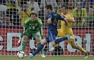 French midfielder Yohan Cabaye (L) scores past Ukrainian goalkeeper Maxym Koval (C) during their Euro 2012 championships football match on June 15. France coach Laurent Blanc said Saturday he was not worried by a thigh niggle that had forced him to take off Cabaye during the 2-0 win over co-hosts Ukraine in their Euro 2012 clash on Friday