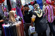 Malaysian Muslims shop ahead of the Eid al-Fitr festival in Kuala Lumpur on August 9, 2012. Malaysia has been rated the world's top Muslim-friendly holiday destination in a survey that listed Egypt, Turkey, United Arab Emirates, Saudi Arabia and Singapore as runners-up