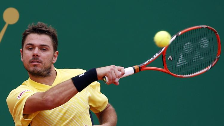Stanislas Wawrinka of Switzerland returns the ball to Marin Cilic of Croatia during the Monte Carlo Masters in Monaco
