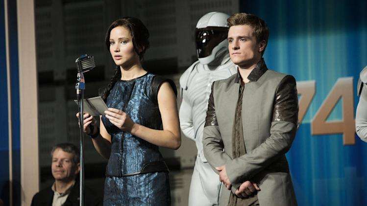 "This publicity photo released by Lionsgate shows Jennifer Lawrence, left, as Katniss Everdeen and Josh Hutcherson as Peeta Mellark in a scene from the film, ""The Hunger Games: Catching Fire."" (AP Photo/Lionsgate, Murray Close)"
