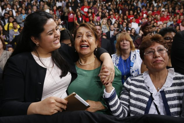 REFILE - CORRECTING NAME OF WOMAN ON RIGHT Lorella Praeli, Chela Praeli and Ligia Jimenez (L-R) listen to U.S. President Barack Obama speak about immigration reform during a visit to Del Sol High School in Las Vegas, Nevada November 21, 2014. Obama imposed the most sweeping immigration reform in a generation on Thursday, easing the threat of deportation for about 4.7 million undocumented immigrants and setting up a clash with Republicans. REUTERS/Kevin Lamarque  (UNITED STATES - Tags: POLITICS SOCIETY IMMIGRATION EDUCATION)