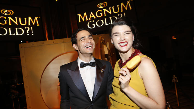 IMAGE DISTRIBUTED FOR MAGNUM - Couture designer Zac Posen, left, and Crystal Renn mingle over MAGNUM Gold?! bars at the premiere of As Good As Gold, a new short film that celebrates the U.S. arrival of MAGNUM Gold?! Ice Cream. The film debuted during the Tribeca Film Festival Thursday, April 18, 2013 in New York. Visit MagnumIceCream.com for more information. (Photo by Jason DeCrow/Invision for MAGNUM/AP Images)