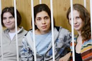 "Members of the all-girl punk band ""Pussy Riot"" Nadezhda Tolokonnikova (C), Maria Alyokhina (R) and Yekaterina Samutsevich (L), attend a court hearing in Moscow, July 20, 2012. A group of British musicians including Pete Townshend and the Pet Shop Boys have urged Russian President Vladimir Putin, due in London on Thursday, to give a fair trial to punk band Pussy Riot"
