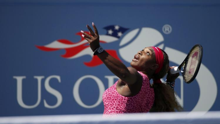 Serena williams of the u s serves to compatriot vania king at the