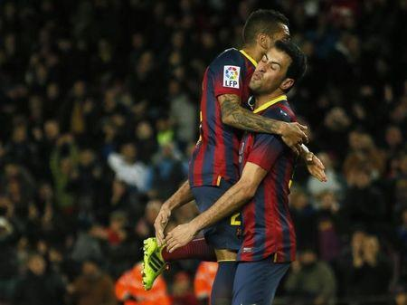 Barcelona's player Busquets celebrates his goal with teammate Alves during their King's Cup semi-final first leg soccer match against Real Sociedad at Nou Camp stadium, in Barcelona