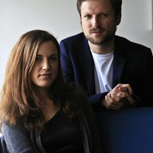 "Journalist Melanie Gouby, left, and filmmaker Orlando von Einsiedel pose before their interview about the film ""Virunga,"" Thursday April 17, 2014 in New York. The film about Virunga National Park in eastern Congo debuts at the Tribeca Film festival on Thursday. (AP Photo/Bebeto Matthews)"