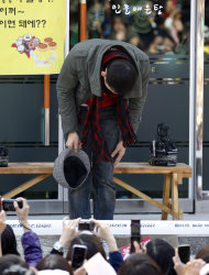 South Korean pop singer Rain bows to his fans before he enters the army to serve in front of an army training center in Uijeongbu, north of of Seoul, South Korea, Tuesday, Oct. 11, 2011. (AP Photo/ Lee Jin-man)
