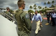 US Secretary of Defense Leon Panetta (centre) boards his plane at Hickam Air force Base in Honolulu, Hawaii. The United States will shift the majority of its naval fleet to the Pacific by 2020 as part of a new strategic focus on Asia, Pentagon chief Leon Panetta has told a summit in Singapore