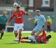 Crewe's Luke Murphy, left, is close to signing a new deal