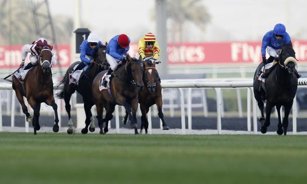 "De Sousa, riding Cavalryman of Britain, races towards the finish line during the third race ""Dubai Gold Cup"" of the Dubai World Cup in Dubai"