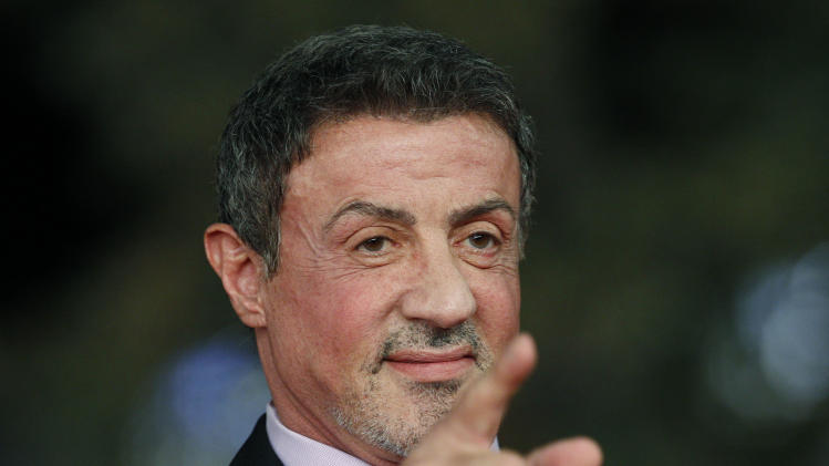 "Actor Sylvester Stallone poses as he arrives for the screening of the movie ""Bullet to the Head"" at the 7th edition of the Rome International Film Festival in Rome, Wednesday, Nov. 14, 2012. (AP Photo/Andrew Medichini)"
