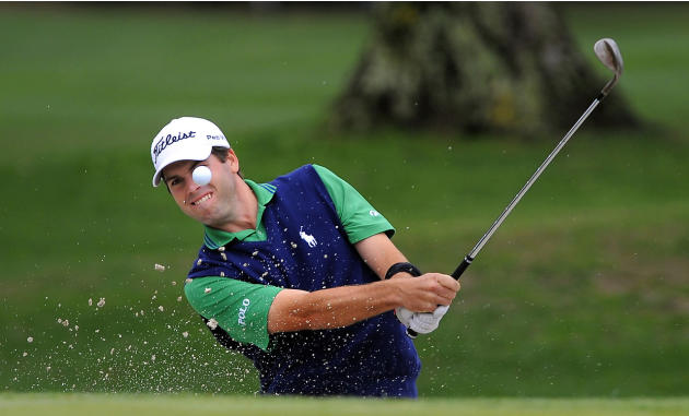 Ben Martin hits out of the bunker on the ninth green during the second round of the RBC Heritage golf tournament in Hilton Head Island, S.C., Saturday, April 19, 2014. (AP Photo/Stephen B. Morton)