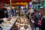 A busy cake stall at London's Borough Market