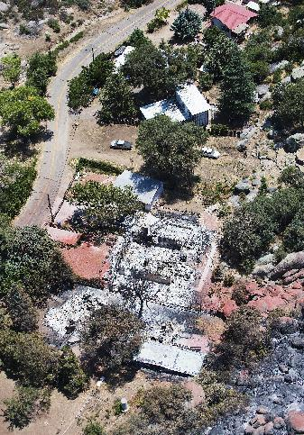 This aerial photo shows Yarnell, Ariz. on Wednesday, July 3, 2013, in the aftermath of the Yarnell Hill Fire that claimed the lives of 19 members of an elite firefighting crew on Sunday. The wildfire has burned structures and forced evacuations as hundreds of firefighters work to contain the blaze. (AP Photo/Tom Tingle)