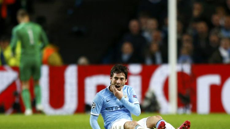 Manchester City's David Silva reacts after a challenge during their Champions League round of 16 first leg soccer match against Barcelona at the Etihad Stadium in Manchester