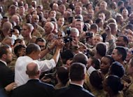 US President Barack Obama greets troops during a visit to Bagram Air Field in Afghanistan. Obama signed a US-Afghanistan strategic partnership agreement during his unannounced visit to the country