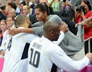 US centre Tyson Chandler is congratulated by First Lady Michelle Obama at the London 2012 Olympic Games. With charm, hidden steel and growing political skill, Michelle Obama is injecting a timely jolt of verve into her husband's battered political brand