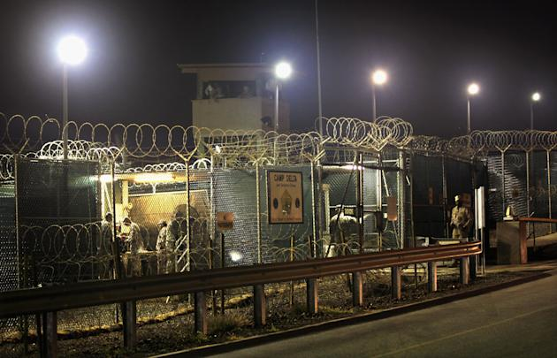 GUANTANAMO BAY, CUBA - SEPTEMBER 16:  (EDITORS NOTE: Image has been reviewed by the U.S. Military prior to transmission.) U.S. military guards finish their overnight shift at Camp Delta at the U.S. de