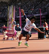 Iraq's Ahmed Naas reacts after a throw in the men's javelin throw F40 final during the athletics competition at the London 2012 Paralympic Games at the Olympic Stadium in east London. Naas won the hearts of the crowd, cartwheeling for joy en route to claiming the silver medal and parading the Iraqi flag