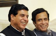 Newly elected Pakistan's Prime Minister Raja Pervez Ashraf (L) and Pervez Elahi the leader of the main coalition party of Pakistan Muslim League Quaid smile during a meeting in Islamabad