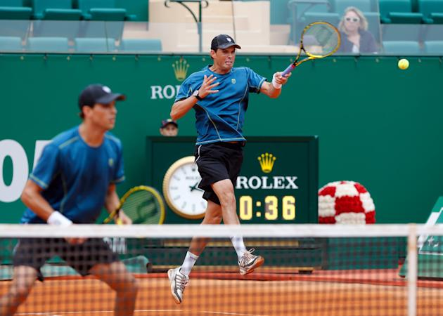 U.S. player Bob Bryan, right,  returns the ball to Ivan Dodig of Croatia and Marcelo Melo of Brazil, as Mike Bryan looks on, during their doubles final match  of the Monte Carlo Tennis Masters tournam