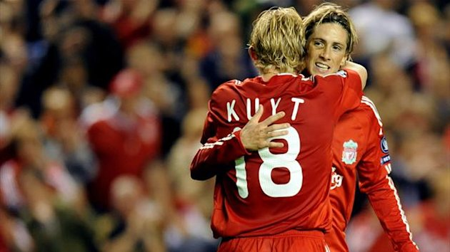 Liverpool's Spanish forward Fernando Torres (R) congratulates Dutch forward Dirk Kuyt as he celebrates scoring against Debrecen during their UEFA Champions League football match at Anfield in Liverpool (AFP)