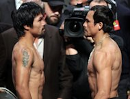 Manny Pacquiao (L) of the Philippines faces Juan Manuel Marquez (R) of Mexico during their weigh-in on December 7 in Las Vegas, Nevada. All eyes will be on the judges when Pacquiao and Manuel Marquez clash in a non-title welterweight bout Saturday at the MGM Grand Hotel