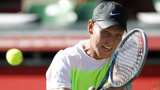 Tomas Berdych of Czech Republic hits a return to Alejandro Falla of Colombia during their second round men's singles match at the Japan Open