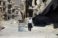 A Syrian man walks down a destroyed street in the centre of Deir Ezzor, the largest city in eastern Syria, on September 6, 2013. The Catholic Church has called for a global day of fasting and prayer on Saturday for peace in Syria and against any armed intervention, with Pope Francis scheduled to host a mass vigil on St Peter's Square