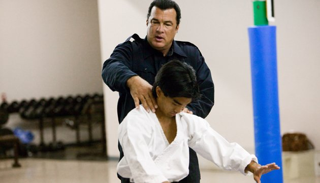 Training day... Seagal teaching kids martial arts skills (Credit: Rex Features)