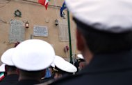 Sailors attend the Costa Concordia shipwreck's first anniversary, on January 13, 2013 on the Italian island of Giglio
