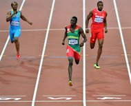 Grenada's Kirani James (C) wins the men's 400m final ahead of Trinidad and Tobago's Lalonde Gordon (R) and Bahamas' Chris Brown (L) at the athletics event of the London 2012 Olympic Games on August 6, 2012 in London. AFP PHOTO / GABRIEL BOUYS