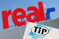 "The logo of German supermarket chain ""Real"" pictured along with the logo of its own food brand ""TiP"" in Hamburg, northern Germany, on February 14, 2013. Germany's Real supermarket said tests on Wednesday had ""found traces of horsemeat"" adding there had been ""at no time evidence of a hygiene risk for consumers"""