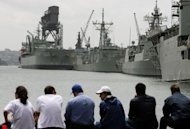 File photo of people looking at the Garden Island Naval Base in Sydney Harbour. The Australian military was rocked Thursday by a new sex scandal, including allegations of assault, child porn, rape and drug-dealing within its ranks