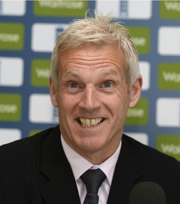 England's Moores smiles during a news conference at Lord's cricket ground in London