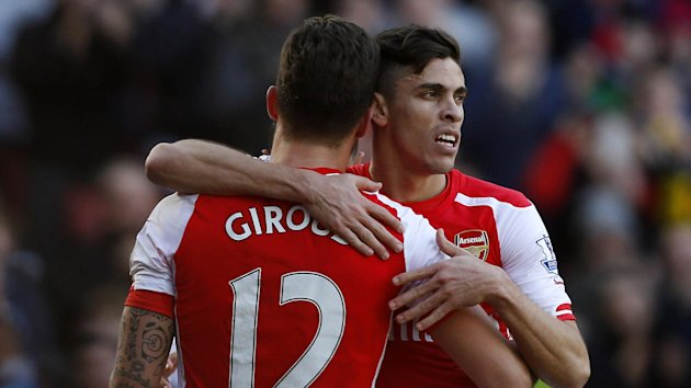 Arsenal's French striker Olivier Giroud (L) celebrates with Arsenal's Brazilian defender Gabriel after scoring the opening goal of the English Premier League football match between Arsenal and Everton at the Emirates stadium (AFP)