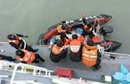The South Korean Coast Guard rescue some of the passengers from a ferry sinking some 20 kilometres off the island of Byungpoong in Jindo on April 16, 2014, in this South Korea Coast Guard image