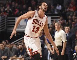 Chicago's Joakim Noah (13) reacts after dislocating his shoulder against the Dallas Mavericks. (USA Today)