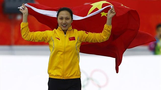 China's Zhang Hong celebrates after the women's 1,000 metres speed skating race at the Adler Arena during the 2014 Sochi Winter Olympics (Reuters)