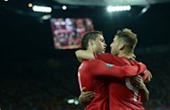 Portuguese forward Cristiano Ronaldo (right) celebrates with Portuguese midfielder Miguel Veloso after scoring during the Euro 2012 match against the Netherlands on Sunday. Portugal's press hailed Ronaldo on Monday for his two goals against the Netherlands that took the side through to the quarter-finals