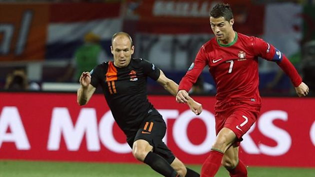 FOOTBALL Portugal forward Cristiano Ronaldo (right) and Netherlands winger Arjen Robben in their Euro 2012 Group B match in Kharkiv on June 17