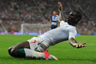 Senegal's Moussa Konate celebrates after scoring during the London 2012 Olympic Games men's football match between Britain and Senegal at Old Trafford in Manchester on July 26, 2012. AFP PHOTO / ANDREW YATES