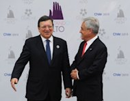 European Commission President Jose Manuel Barroso (L), is welcomed by Chilean President Sebastian Pinera to the opening of the Latin American and Caribbean States-European Union Summit in Santiago, on January 26, 2013. European and Latin American leaders pledged to shun protectionism and boost their strategic partnership to foster free trade.