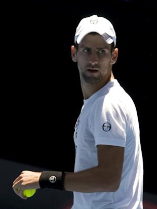 Photo 1 - Novak Djokovic Of Serbia Reacts AFP/Getty Images