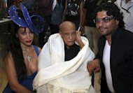 "Indian Bollywood veteran actor A.K. Hangal (centre) with actress Eleanor Sophie Hyat and designer Riyaz Ganji in Mumbai last year. Hangal, dubbed the ""grand old man"" of Hindi cinema for his elderly roles, died on Sunday aged 95"