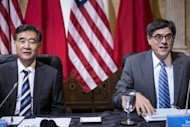 Chinese Vice Premier Wang Yang (L) and US Secretary of the Treasury Jack Lew wait for a roundtable meeting at the US Department of the Treasury, July 11, 2013 in Washington