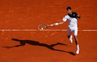 MONTE-CARLO, MONACO - APRIL 17: Novak Djokovic of Serbia in action against Pablo Carreno Busta during day five of the ATP Monte Carlo Rolex Masters Tennis at Monte-Carlo Sporting Club on April 17, 2014 in Monte-Carlo, Monaco. (Photo by Julian Finney/Getty Images)