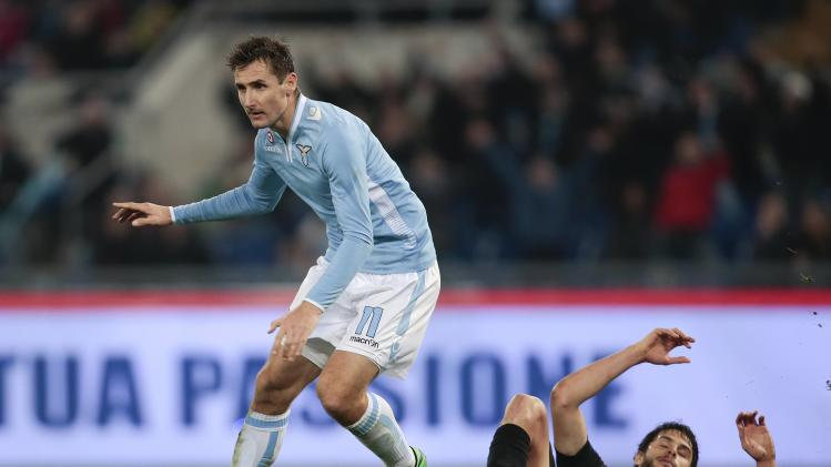 Lazio's Klose celebrates after scoring against Inter Milan during their Italian Serie A soccer match at the Olympic stadium in Rome