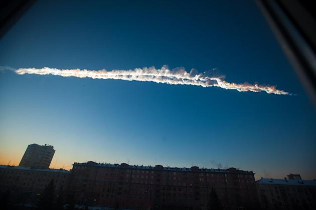 In this photo provided by Chelyabinsk.ru a meteorite contrail is seen over Chelyabinsk on Friday, Feb. 15, 2013. A meteor streaked across the sky of Russia's Ural Mountains on Friday morning, causing